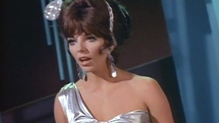 Joan Collins as The Siren
