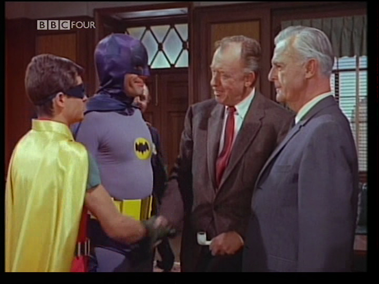 David Lews as Warden Crichton with Batman & Robin